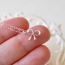 Tiny Bow Necklace in Sterling Silver