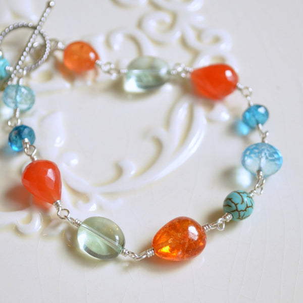 Sterling Silver Bracelet with Carnelian, and Blue Topaz