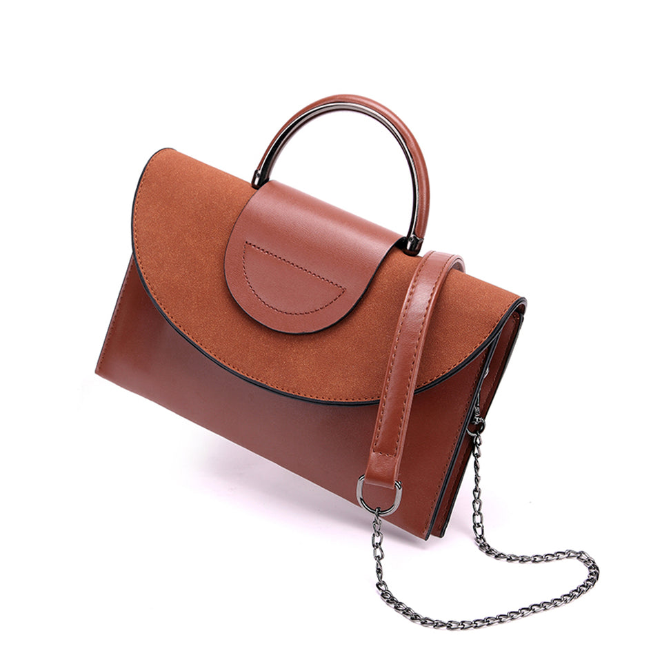 Layered flap faux leather crossbody clutch in Brown