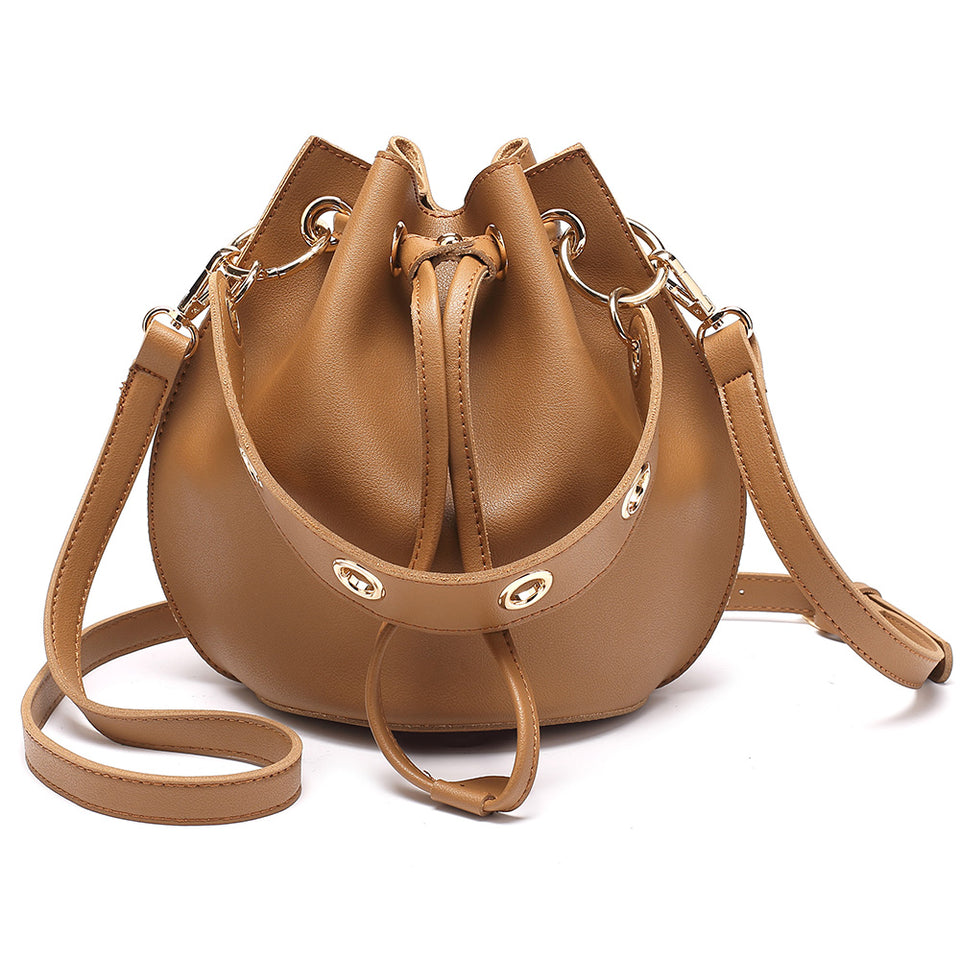 Eyelet drawstring faux leather bucket bag in Brown
