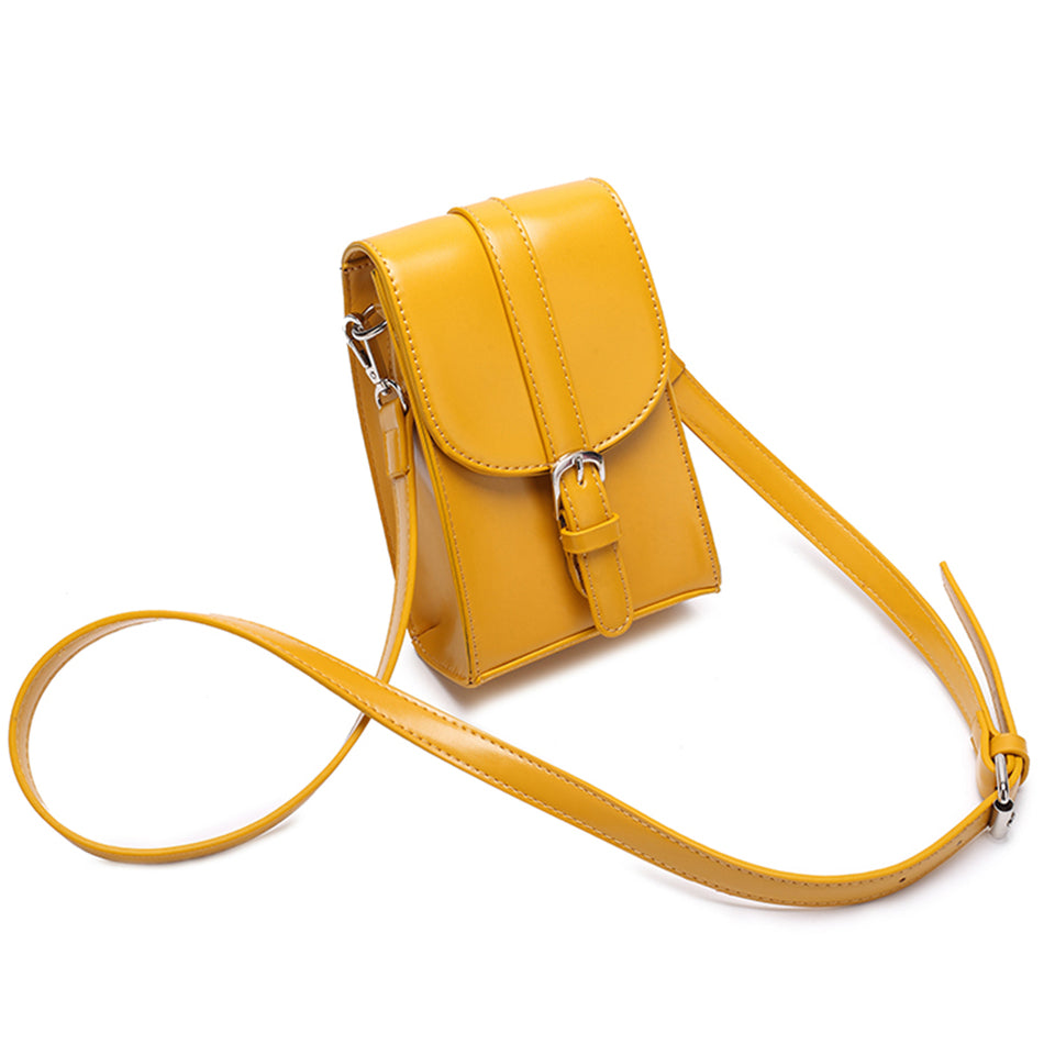 Mini faux leather crossbody bag in Mustard yellow