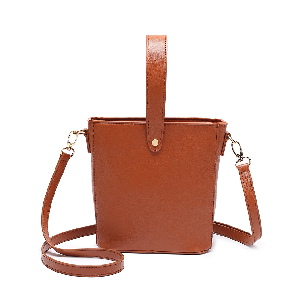 Inverted handle faux leather bucket crossbody bag in Brown