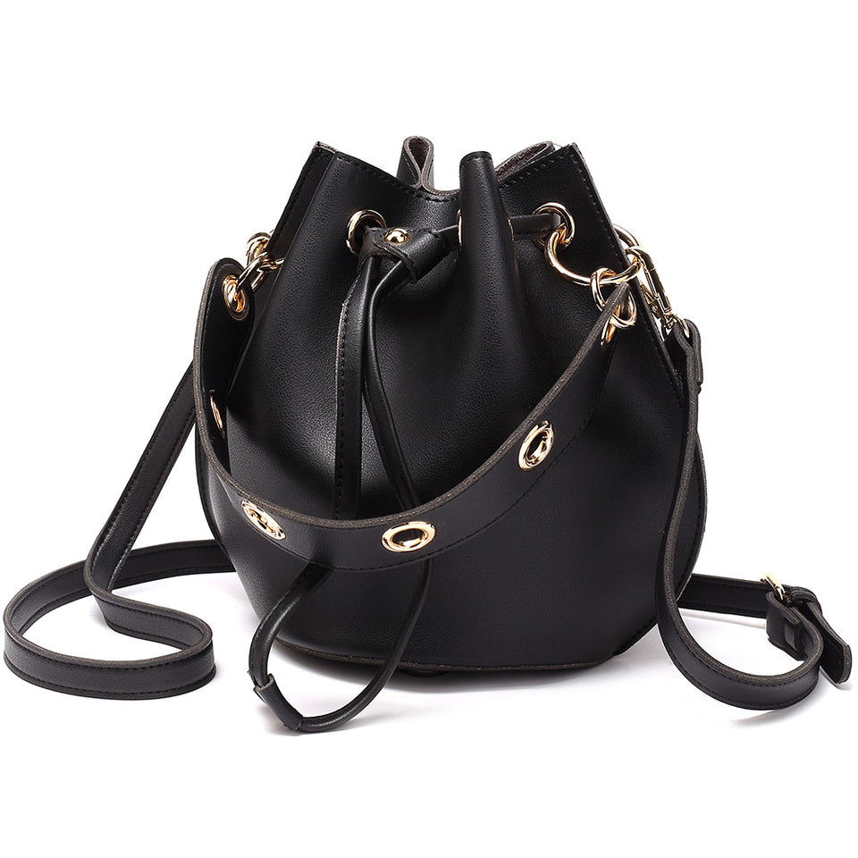 Eyelet drawstring faux leather bucket bag in Black