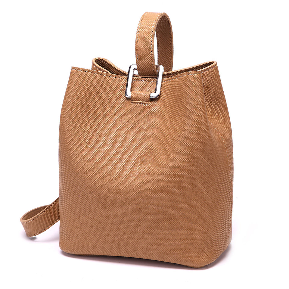 Cutout metal hardware faux leather bucket bag in Brown