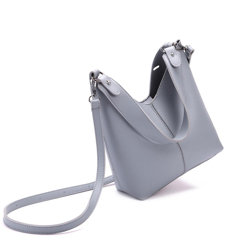 Cut-out sculptural faux leather 2-in-1 bag in Slate blue