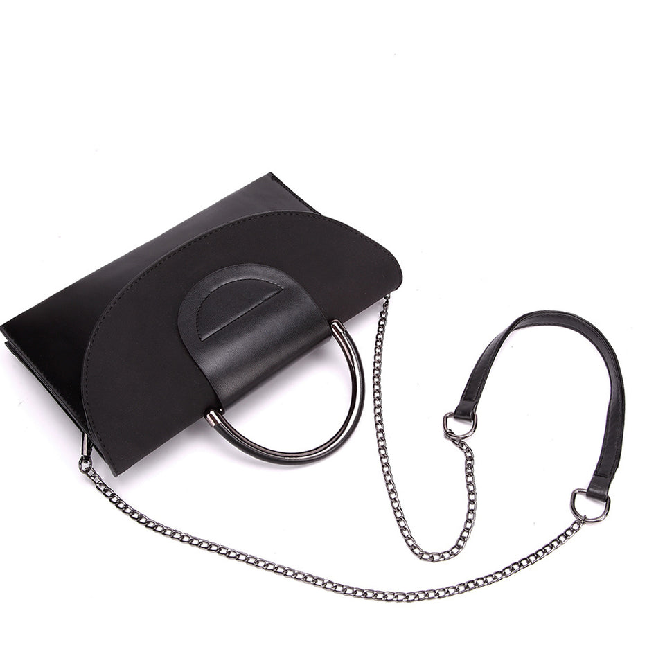 Layered flap faux leather crossbody clutch in Black