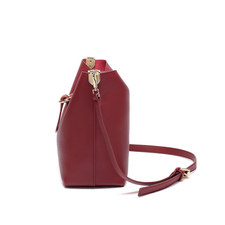 Belted flapover faux leather 2-in-1 bag in Wine red