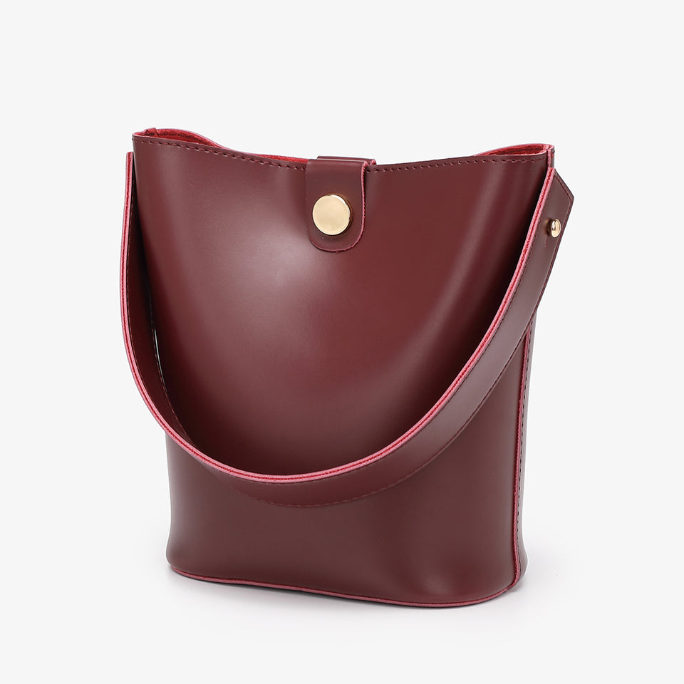 Studded PU leather 2-in-1 bucket bag in burgundy