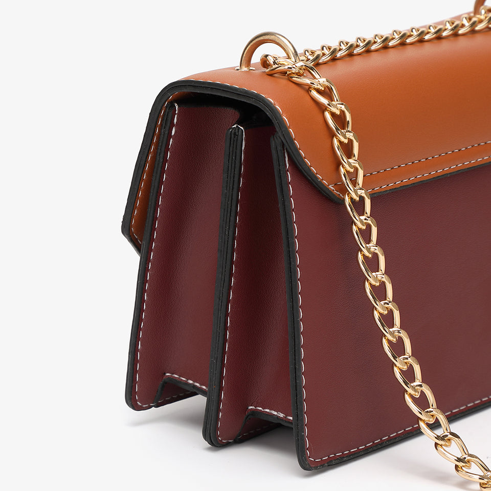 Asymmetric geometric colourblock crossbody bag in brown
