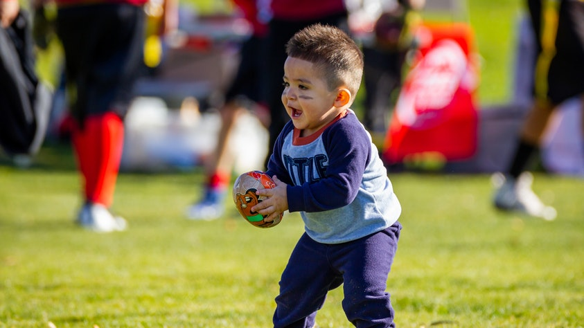 12 Classic Outdoor Games To Get Kids Outside And Moving! football boy