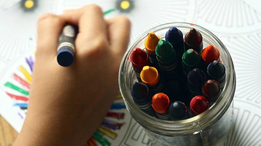 Fun and Low-budget Playtime Ideas kid playing crayons