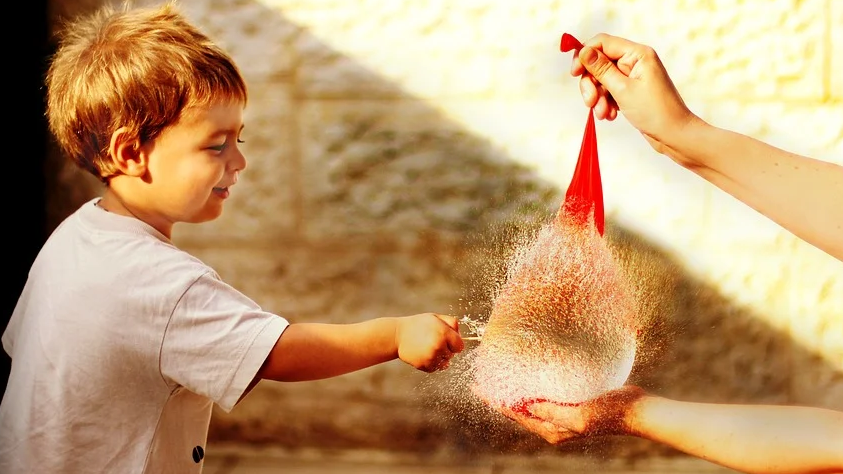 Fun and Low-budget Playtime Ideas kid popping water balloon