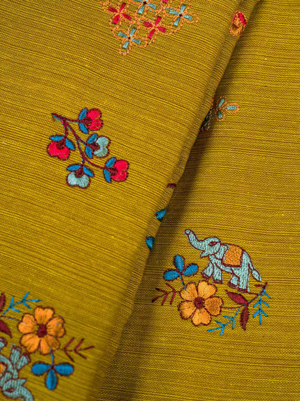 Rust Yellow Embroidered Cotton Fabric.