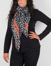 an image showing a leopard print scarf with orange border