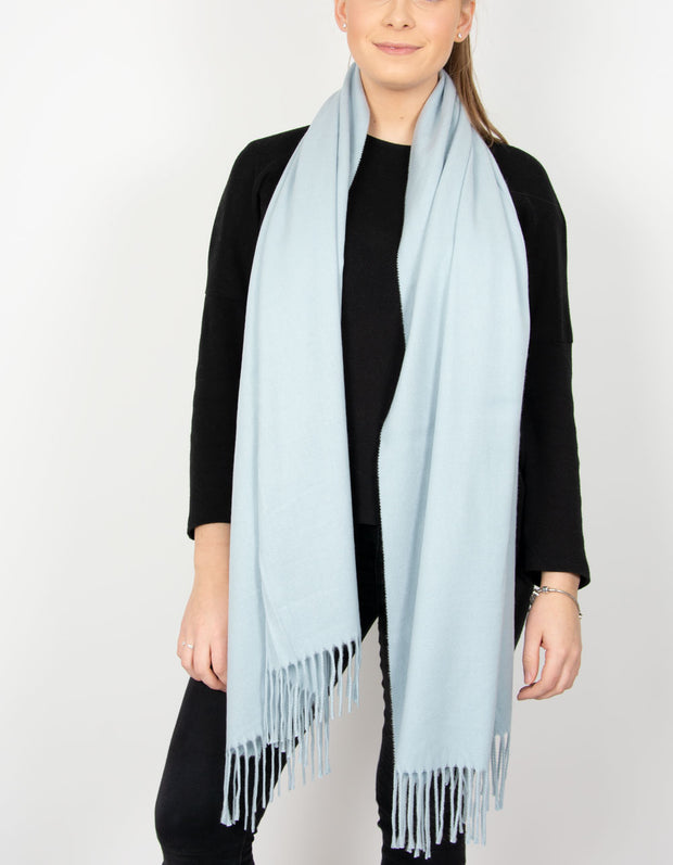 an image showing a baby blue blanket scarf