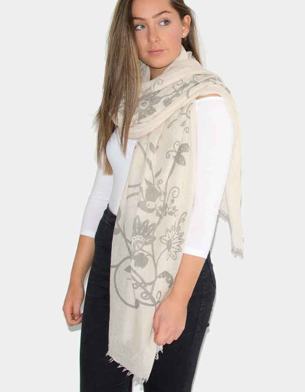 an image showing a beige butterfly print scarf