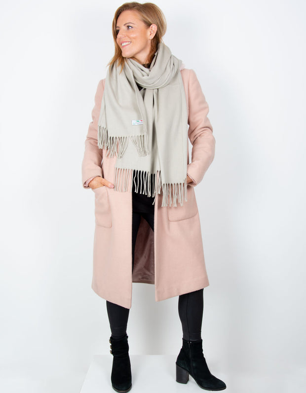 an image showing a beige blanket scarf