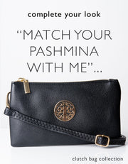 an image showing a black clutch bag