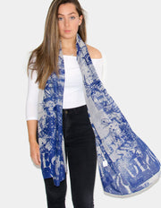 an image showing a blue scarf with butterfly print