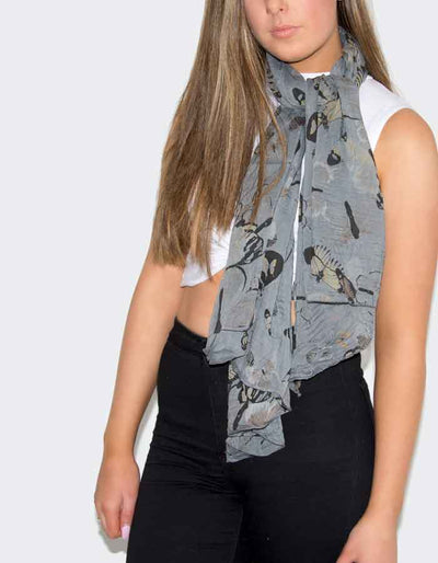 an image showing a grey butterfly print scarf