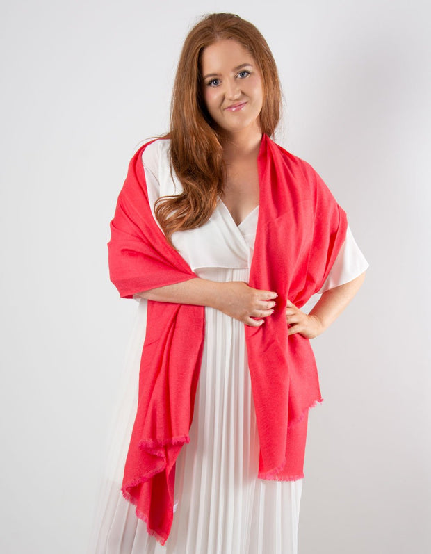 an image showing a coral cashmere pashmina for weddings