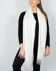 an image showing a cream blanket scarf