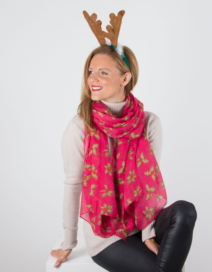 Image Showing a Fuchsia Pink Christmas Scarf With Holly Print