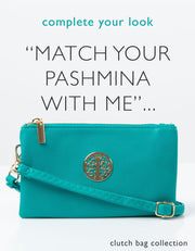 an image showing a green clutch bag