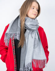 an image showing a grey and dark grey mulberry print blanket scarf