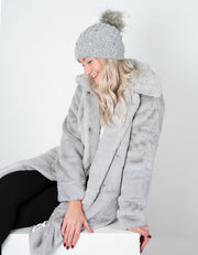 an image showing a grey diamante and pearl cashmere bobble hat