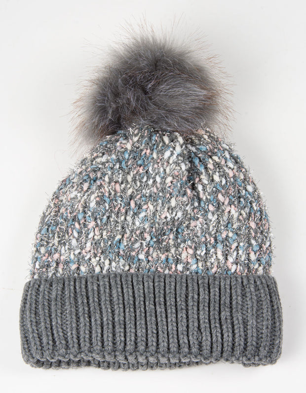 an image showing a grey and pink shimmer bobble hat