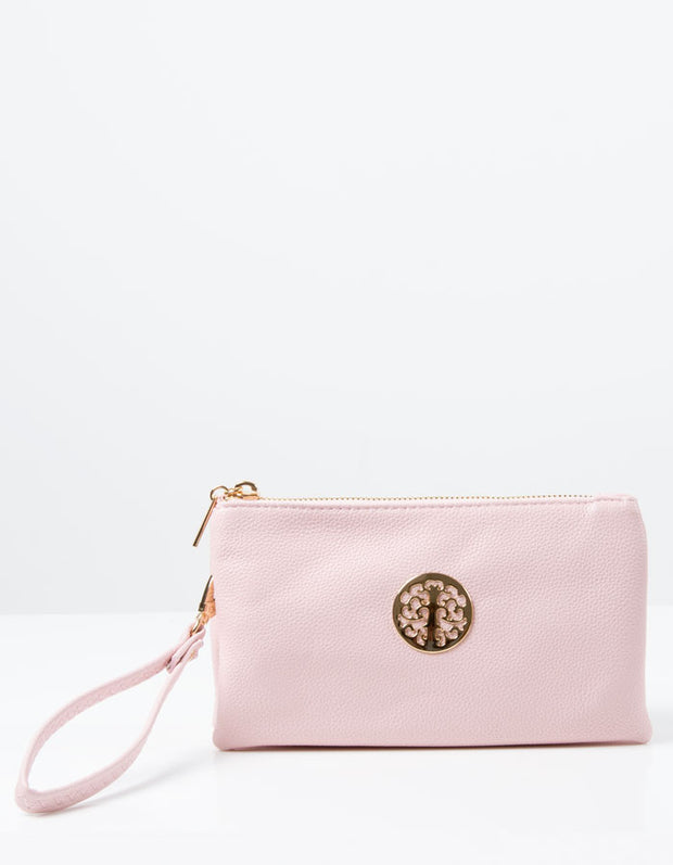an image of a pale pink clutch bag
