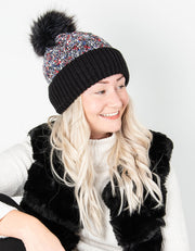 an image showing a black and red shimmer bobble hat