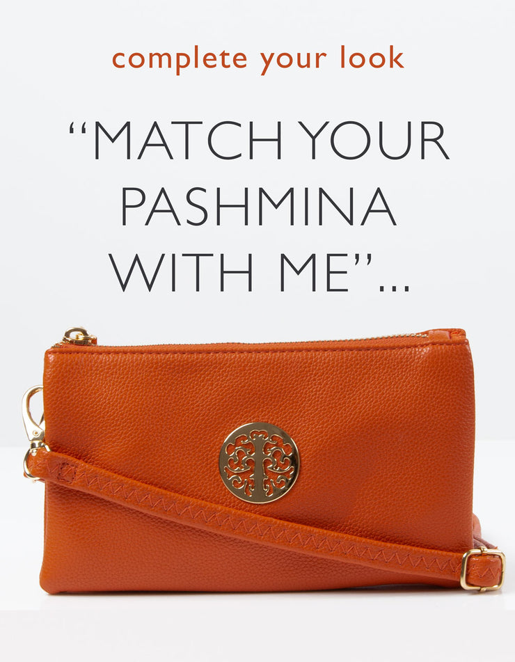 an image showing an orange clutch bag