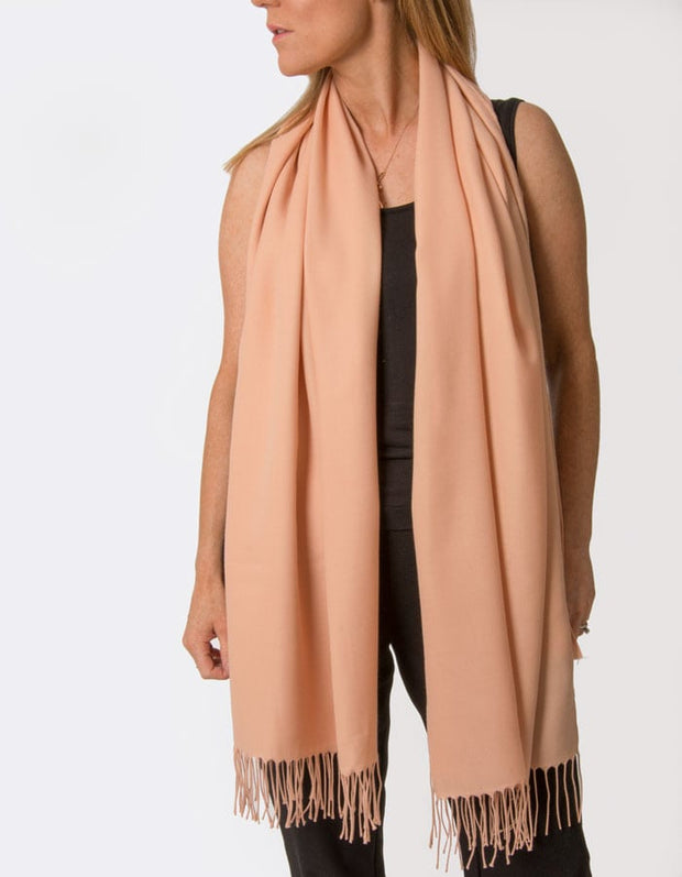 an image showing a peach pink coloured pashmina