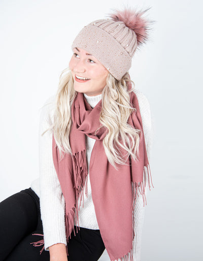 an image showing a pink diamante and pearl cashmere bobble hat