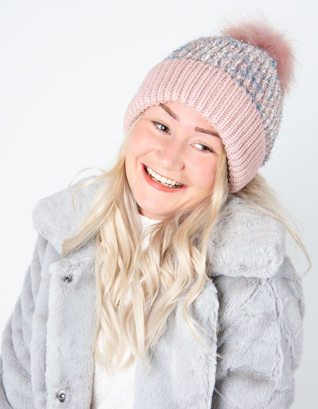 an image showing a pink shimmer bobble hat
