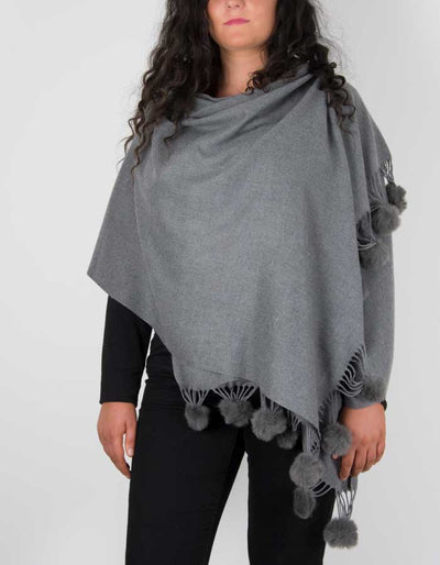 an image showing a pashmina with pom poms in grey
