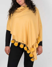 an image showing a pashmina with pom poms in mustard