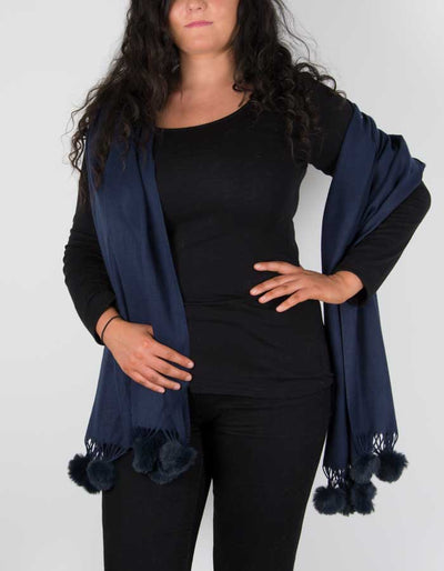 an image showing a pashmina with pom poms in navy blue