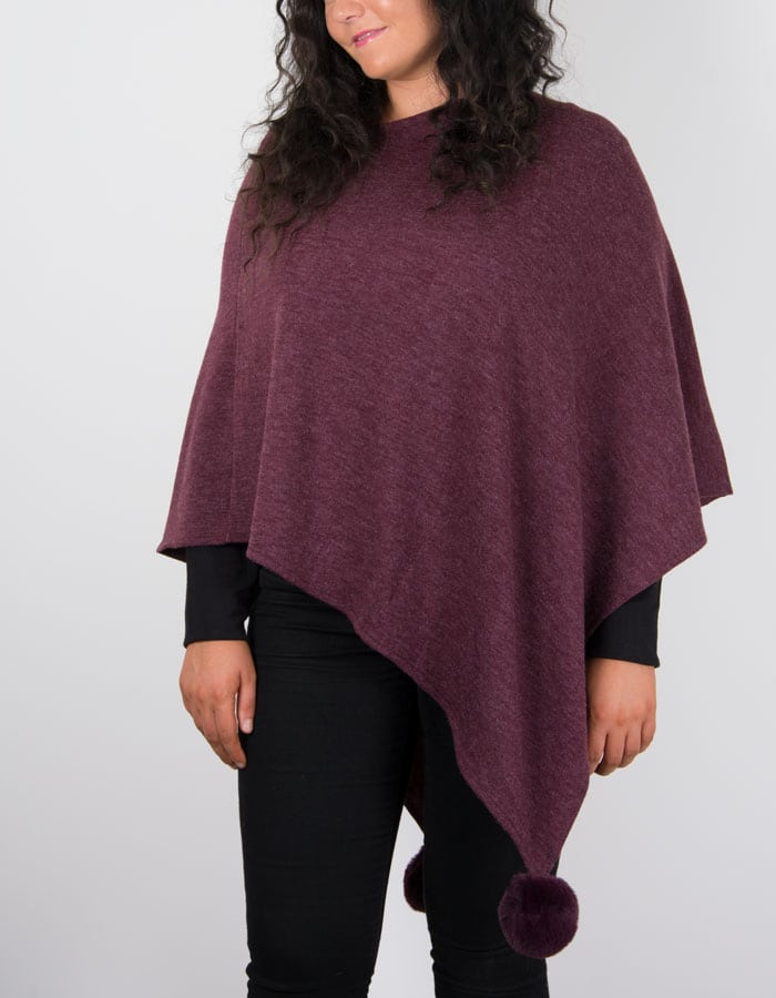 an image showing a burgundy poncho