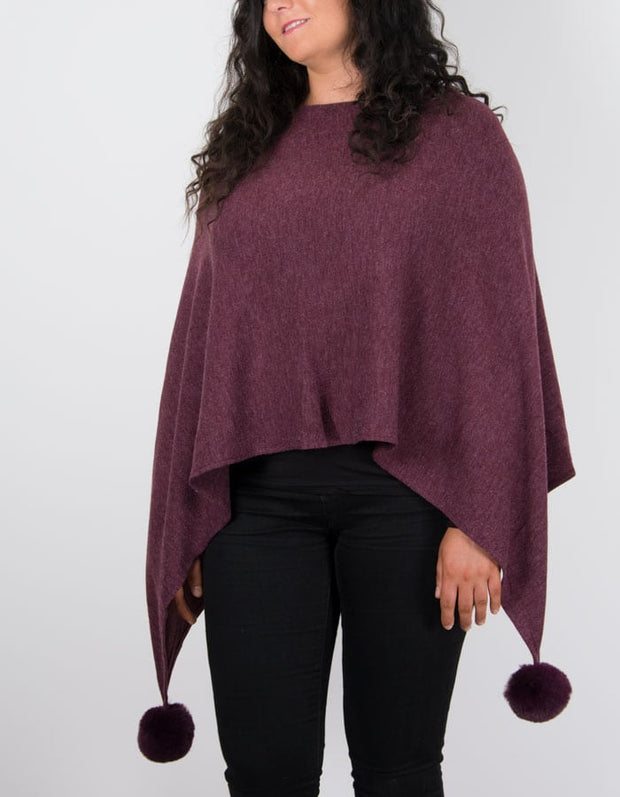 An image showing a poncho in burgundy