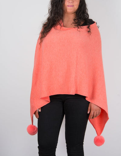 An image showing a poncho in coral