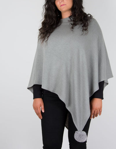 An image showing a dark grey poncho
