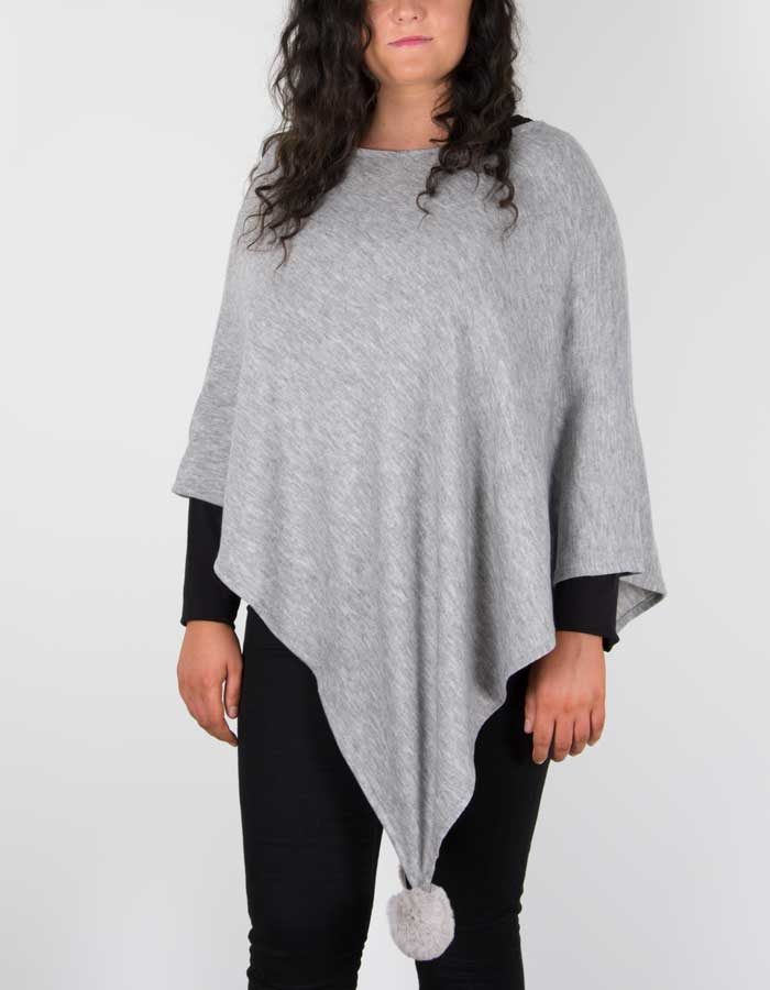 An image showing a light grey poncho