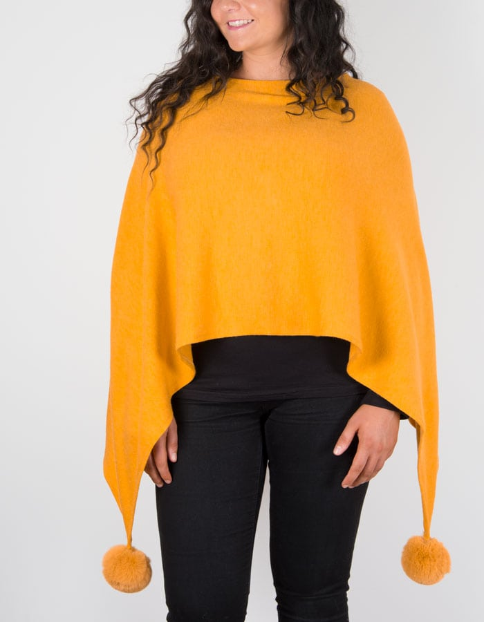 An image showing a mustard poncho