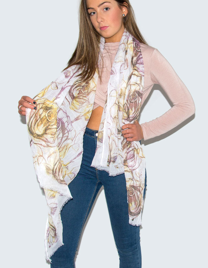 An image showing a purple and yellow tulip print scarf
