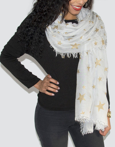 an image showing a white and gold star scarf