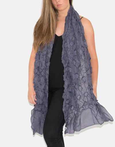 an image showing a purple floral scarf