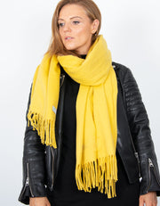 an image showing a yellow blanket scarf